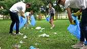 Friendly family organized cleaning day to clean park of household garbage