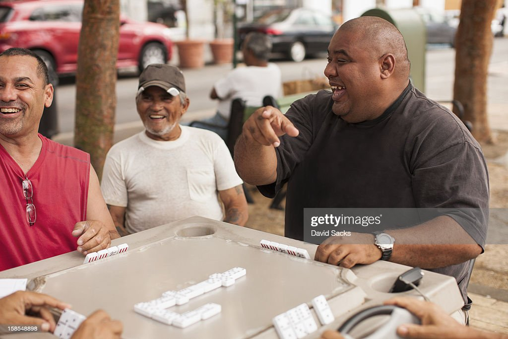 Friendly game of Dominos : Stock Photo