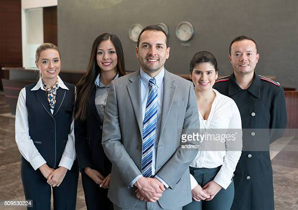 Friendly hotel staff smiling