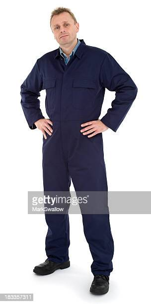 Friendly mechanic posing for picture in Navy jumpsuit