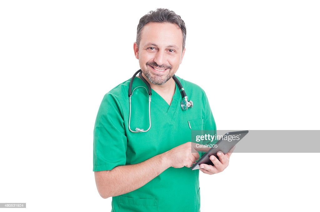 Friendly medical consultant holding tablet : Stock Photo