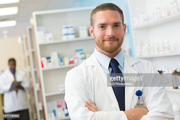Friendly pharmacist at his pharmacy