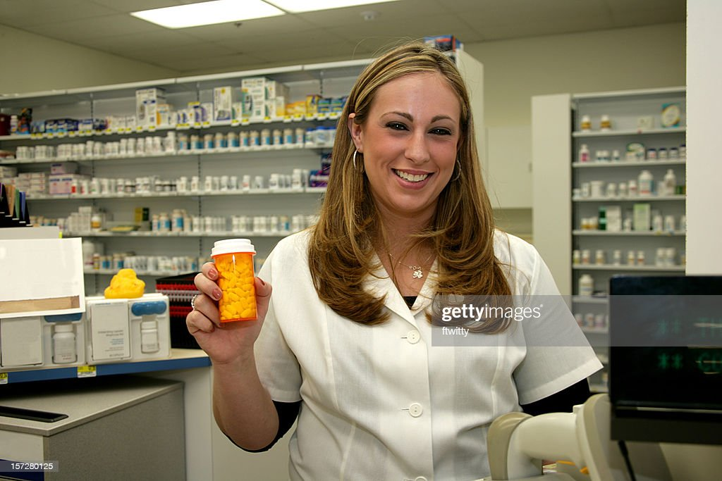 Friendly Pharmacist with Pills : Stock Photo