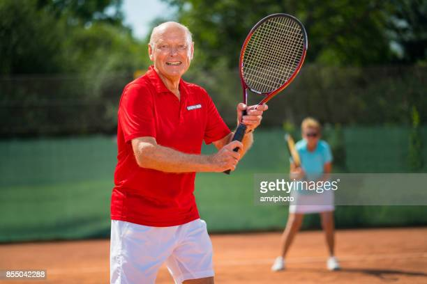 friendly smiling 73 years old tennis player