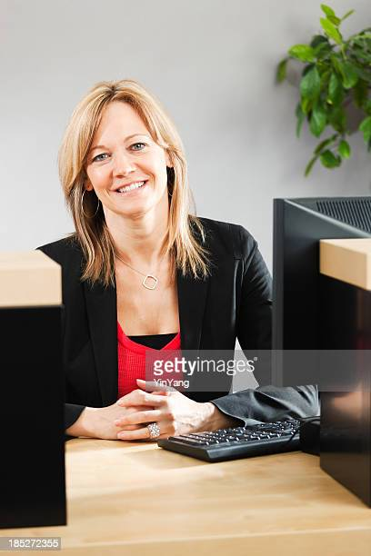 Friendly Smiling Bank Teller in Retail Banking Customer Counter Vt