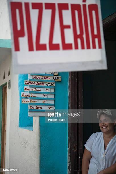 Friendly woman at peso pizza shop.