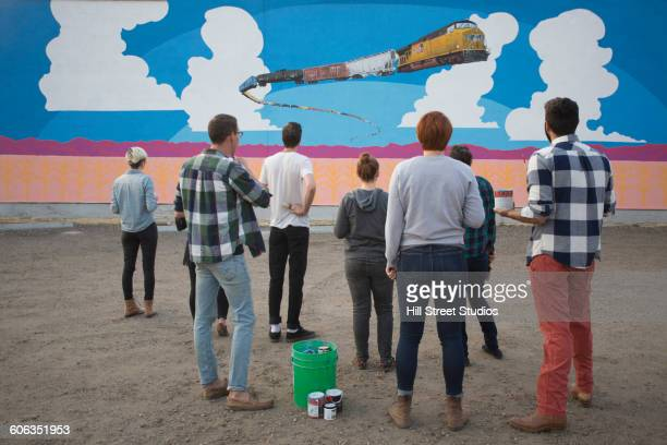 Friends admiring mural wall