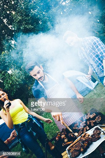 Friends and barbecue : Stock Photo