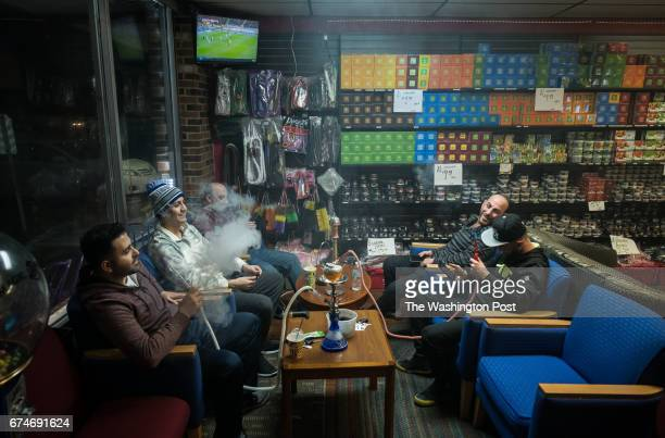 Friends and business owners gather after work at Shisha Town a local hookah shop on Sunday March 26 in Sterling Heights MI