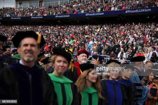 Friends and families of graduates wait for the beginning of a commencement at Liberty University May 13 2017 in Lynchburg Virginia President Donald...