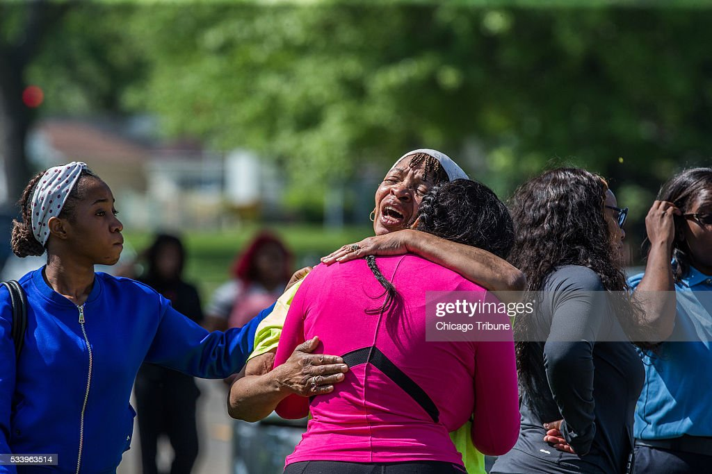 Friends and family console each other as FBI investigate a shooting at 5 Rich Ct. on Tuesday, May 24, 2016 in Park Forest, Ill.