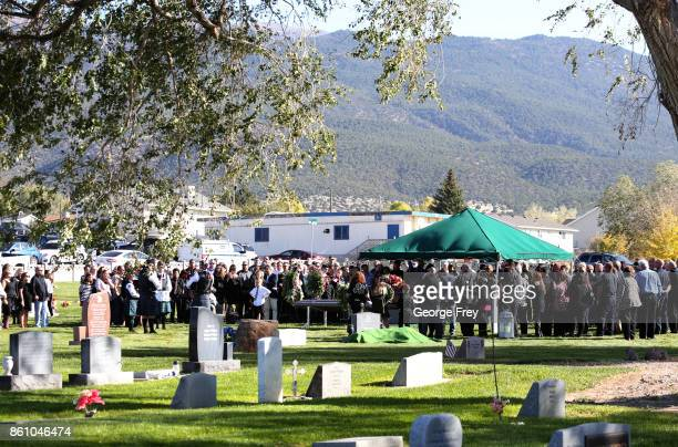 Friends and family gather for a grave side service of Heather Lorraine Alvarado on October 13 2017 in Enoch Utah Alvarado was a 35 year old wife and...