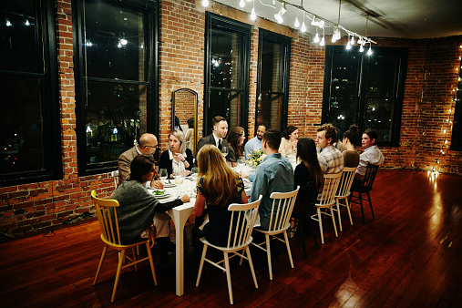 Friends and family gathered at table during dinner