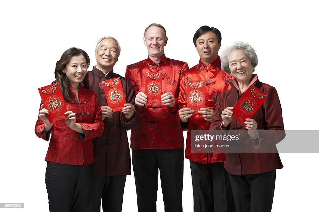 Friends and family hold red envelopes for Chinese New Year