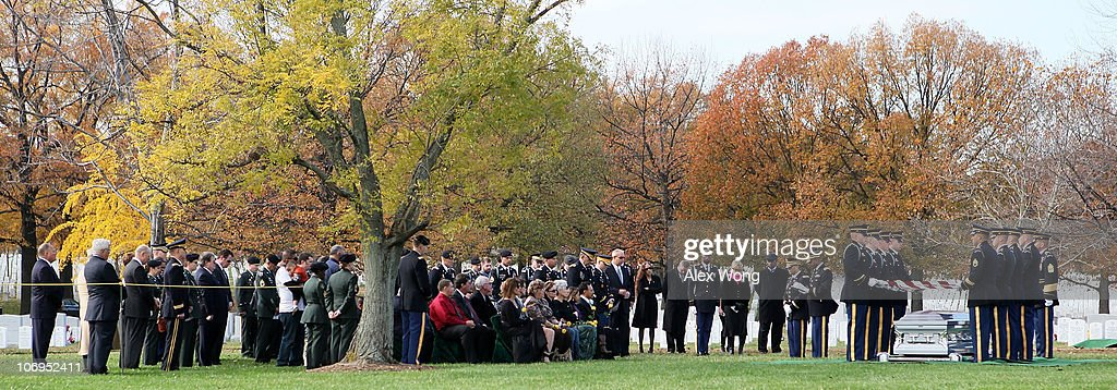 Friends and family members attend a group burial service for Army Staff Sergeant Luis M Gonzalez of South Ozone Park New York Sergeant Fernando...