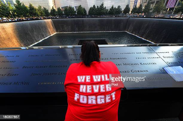 Friends and family members gather at the 9/11 Memorial during ceremonies marking the 12th anniversary of the 9/11 attacks on the World Trade Center...