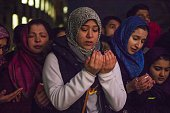 Friends and family members pray at a vigil for Deah Shaddy Barakat his wife Yusor AbuSalha and her sister Razan AbuSalha on the campus of North...