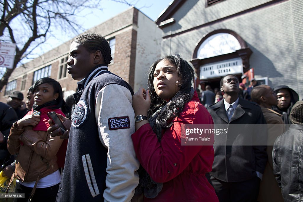 Friends and family of Kimani Gray, 16, watch as his casket is carried out after a funeral service on March 23, 2013 in the Brooklyn borough of New York City. Kimani Gray was shot and killed by New York police officers for allegedly pointing a gun at them.