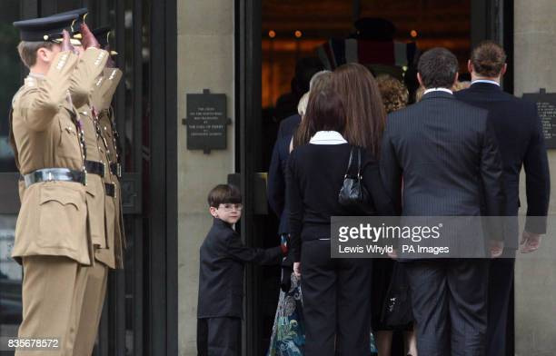 Friends and family of Major Sean Birchall of the 1st Battalion Welsh Guards follow his coffin into the Guards Chapel London for his funeral service