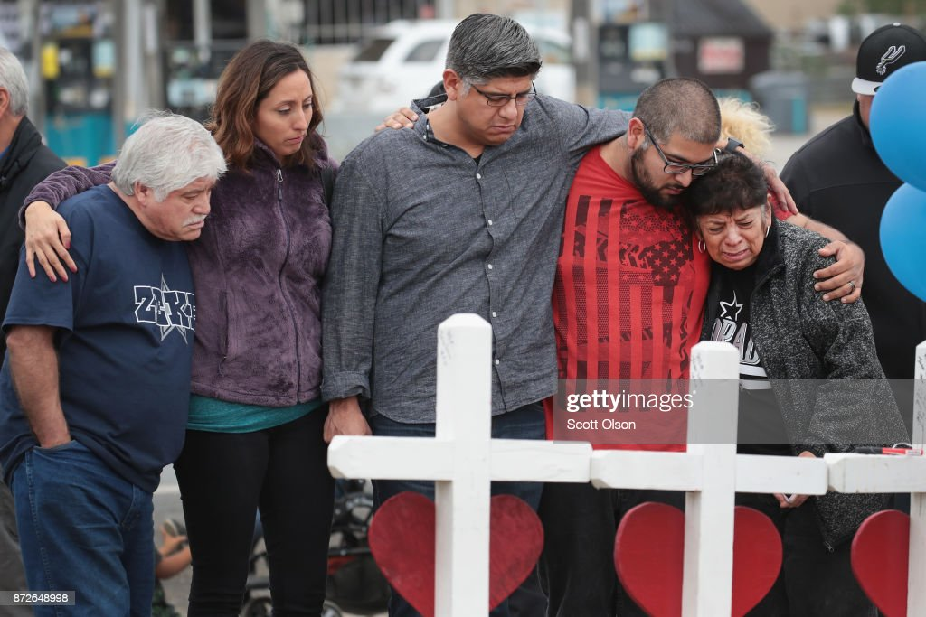 Friends and family of Ricardo and Therese Rodriguez mourn their loss while visiting a memorial where 26 crosses were placed to honor the 26 victims killed at the First Baptist Church of Sutherland Springs on November 10, 2017 in Sutherland Springs, Texas. Ricardo and Therese wiill be buried tomorrow in Sutherland Springs Cemetery. On November 5, a gunman, Devin Patrick Kelley, shot and killed the 26 people and wounded 20 others when he opened fire during Sunday service at the church.