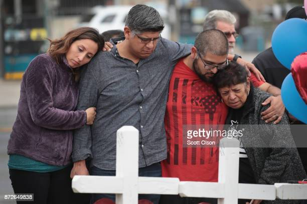 Friends and family of Ricardo and Therese Rodriguez mourn their loss while visiting a memorial where 26 crosses were placed to honor the 26 victims...