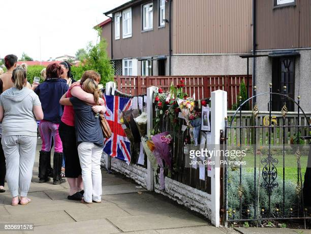 Friends and family of Rifleman Jimmy Backhouse who was killed whilst serving in Afghanistan leave tributes and sign messages on a Union flag outside...