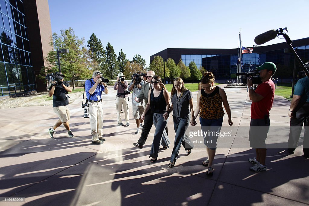 Friends and family of victims of last Friday's movie theater mass shooting arrive at the Arapahoe County Courthouse for suspect James Holmes' first court appearance July 23, 2012 in Centennial, Colorado. Arapahoe County District Attorney Carol Chambers said the prosecutor's office would consult with family members when deciding whether or not to pursue the death penalty for James Holmes, 24, who is accused of killing 12 people and injuring 58 in a shooting spree July 20, during a screening of 'The Dark Knight Rises.' in Aurora, Colorado.