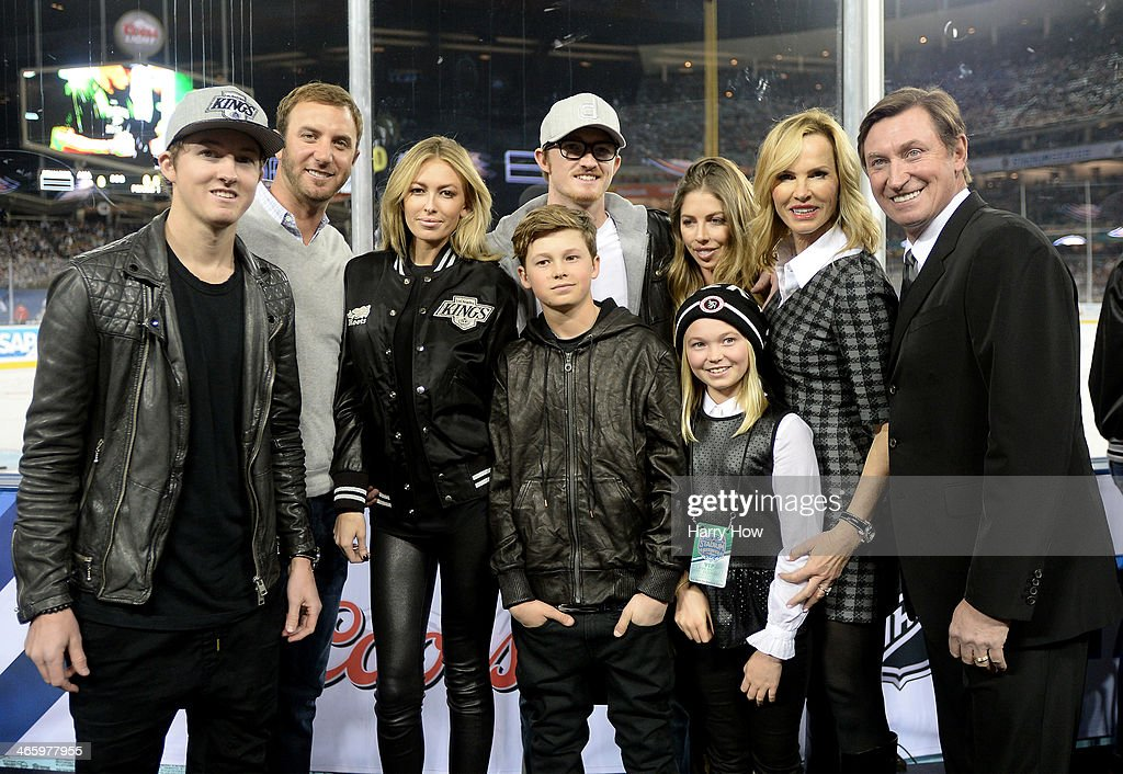 Friends and family of Wayne Gretzky including Dustin Johnson pose for a photo during the 2014 Coors Light NHL Stadium Series at Dodger Stadium on January 25, 2014 in Los Angeles, California.