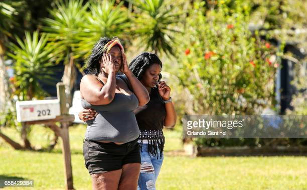 Friends and family respond as Sanford Police work at the scene of an early morning shooting in Sanford Fla that left one dead and 5 otheres injured...