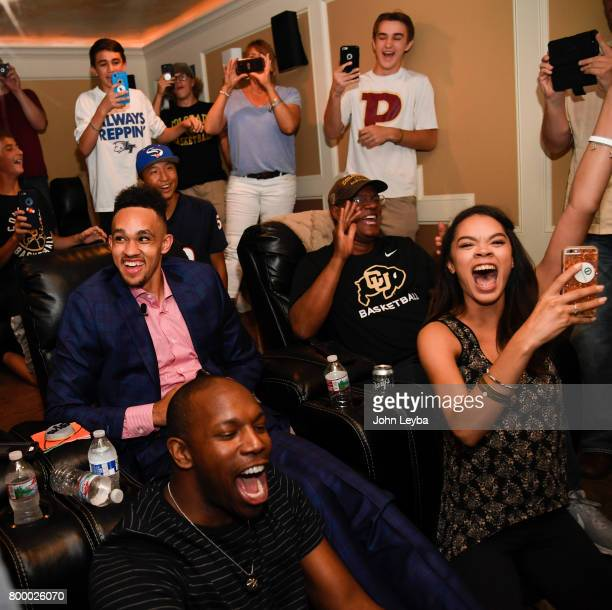 Friends and family scream out as Derrick White sits calmly in his chair after the announcement that the San Antonio Spurs had selected him 29th in...