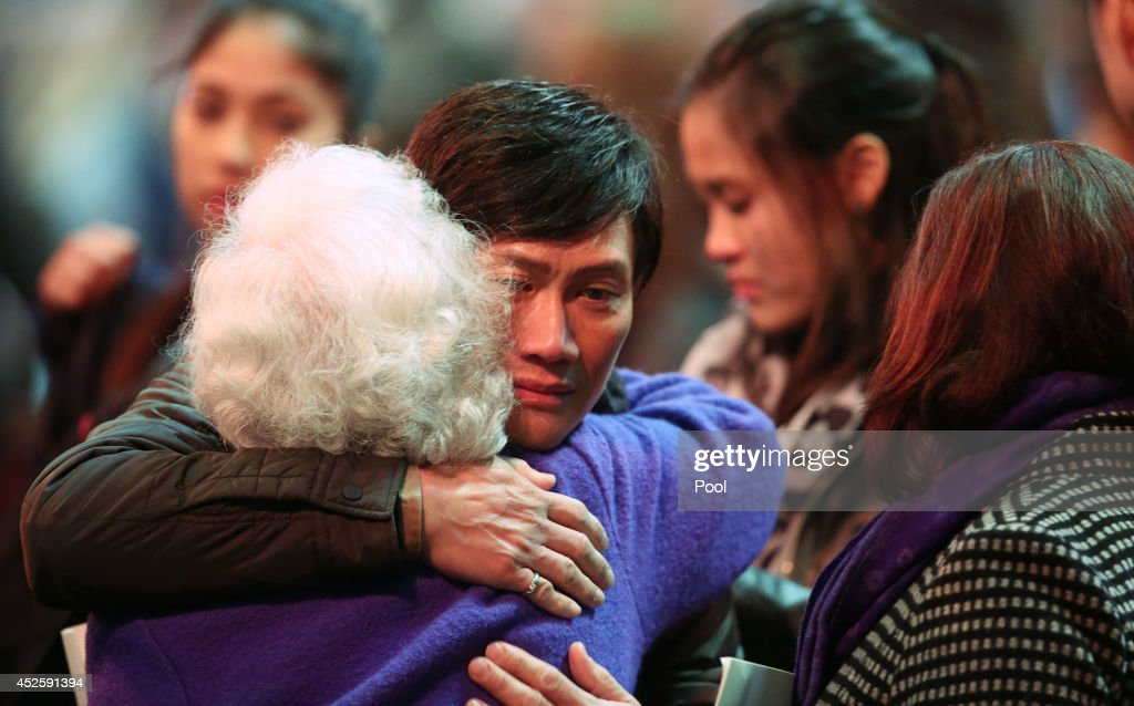 Friends and family share their grief at a Multifaith memorial service held for victims of the MH17 disaster at St Paul's Cathedral on July 24 2014 in...