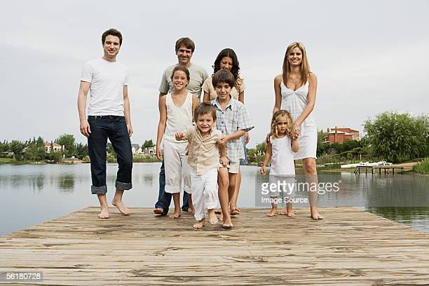 Friends and family standing on a pier
