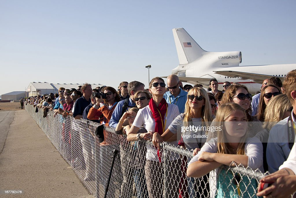 Friends and family watch as the aircraft climbs for the first powered flight of Virgin Galactic's SpaceShipTwo on April 29, 2013 in Mojave, California. SpaceShipTwo is a private enterprise aircraft, designed to carry paying passengers into space. The spacecraft was dropped from the mothership at high altitude and fired it's engine for a approximate 16-second burn taking the craft through the sound barrier. The hybrid rocket motor is fueled by nitrous oxide and a rubber propellent combination. The motor can be 'shut down' at any time for safety and flight requirement purposes.