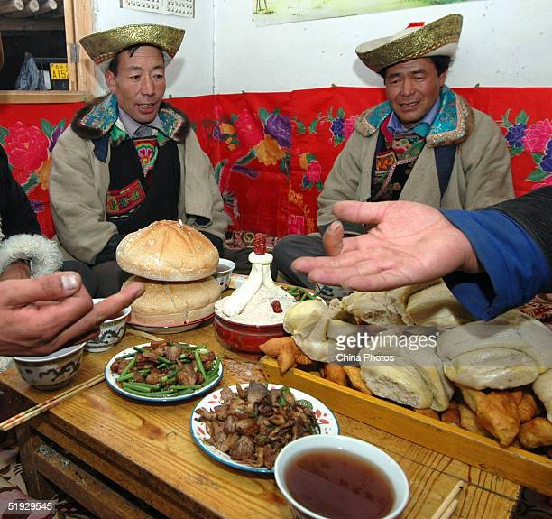 Friends and matchmakers have dinner and play games at the groom's home before a local Tu ethnic minority group wedding ceremony on January 7 2005 in...