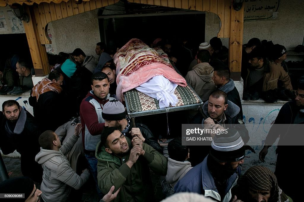 Friends and relatives carry the body of Palestinian Mussa Jaber al-Maadi, who died after a tunnel collapsed, during his funeral on February 8, 2016, in Rafah in the southern Gaza Strip. Al-Maadi died when a tunnel he was trying to restore collapsed near Gaza's border with Egypt, Palestinian medical and security sources said. The death brings to 10 the number of Gazans killed in three separate tunnel collapses in two weeks. KHATIB
