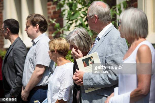 Friends and relatives look on as the coffin of Jon Underwood leaves the Jamyang Buddhist Centre following the funeral on July 6 2017 in London...