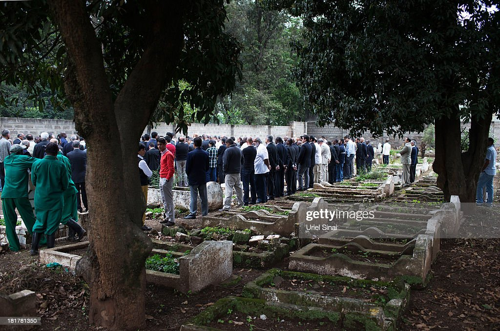 Friends and relatives mourn during a funeral service for Selima Merali (41) and her daughter Nuriana Merali (15), who were killed in the attack by gunmen at the Westgate Shopping Centre, on September 25, 2013 in Nairobi, Kenya. The country is observing three days of national mourning as security forces begin the task of clearing and securing the Westgate shopping mall following a four-day siege by militants.