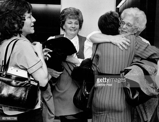 Friends and relatives of child abuse victim hug each other after verdict was in on the Jenson case at the District one Courthouse in Golden Credit...