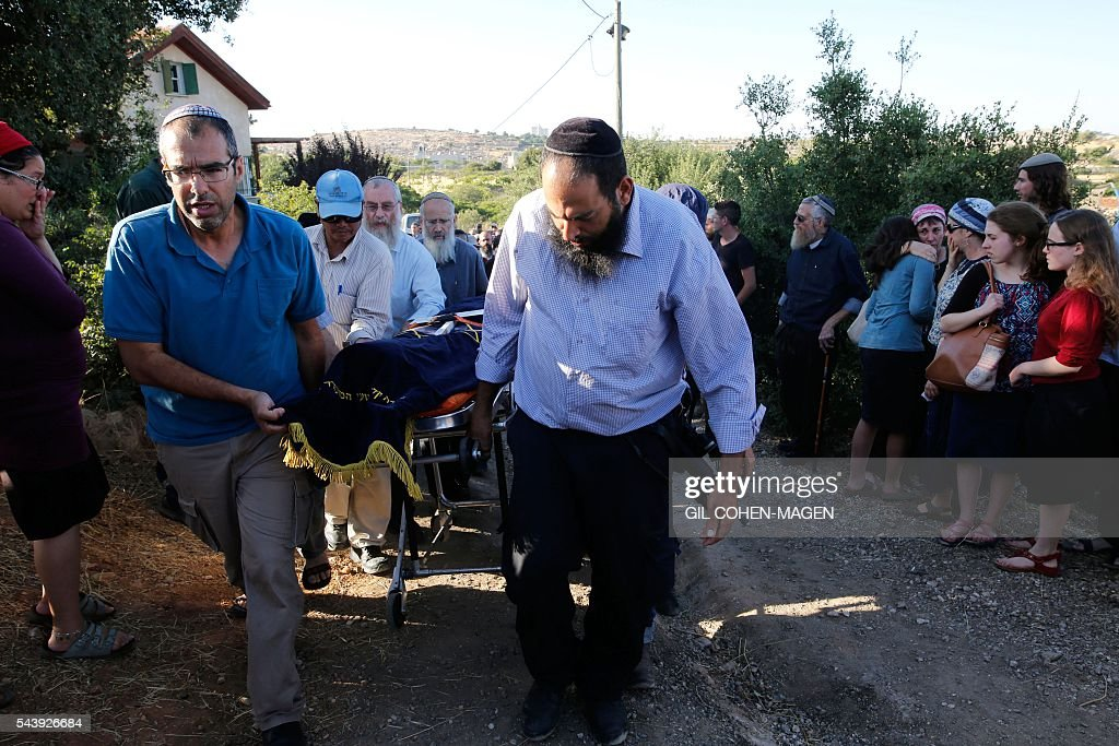 Friends and relatives of Israeli Hallel Yaffa Ariel, a 13-year-old girl who was fatally stabbed by a Palestinian attacker in her home, carry her body during her funeral in the Kiryat Arba settlement outside the Israeli occupied West Bank city of Hebron on June 30, 2016. The Israeli army said that a young Palestinian killed Hallel in her bed after breaking into her home in the Kiryat Arba settlement outside the flashpoint city of Hebron. Security personnel rushed to the house and fired on the attacker, who wounded a guard before being shot dead, the army said. The girl was taken to hospital in Jerusalem in critical condition and died of her wounds. / AFP / GIL