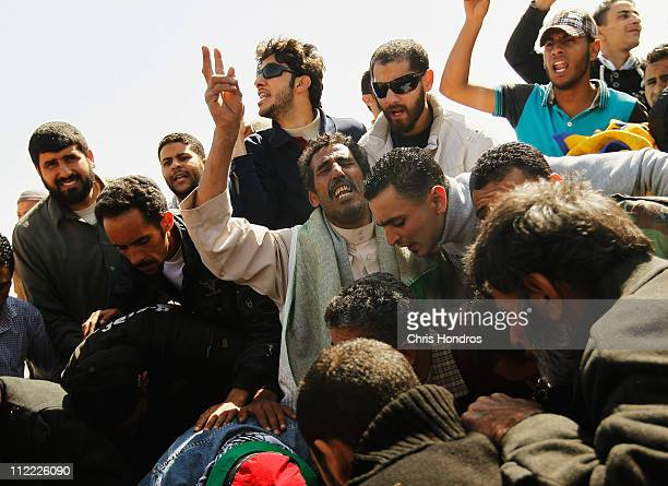 Friends and relatives of Ramadan Omar Balah shout out during his burial April 15 2011 in Benghazi Libya Balah an rebel against longtime Libyan ruler...