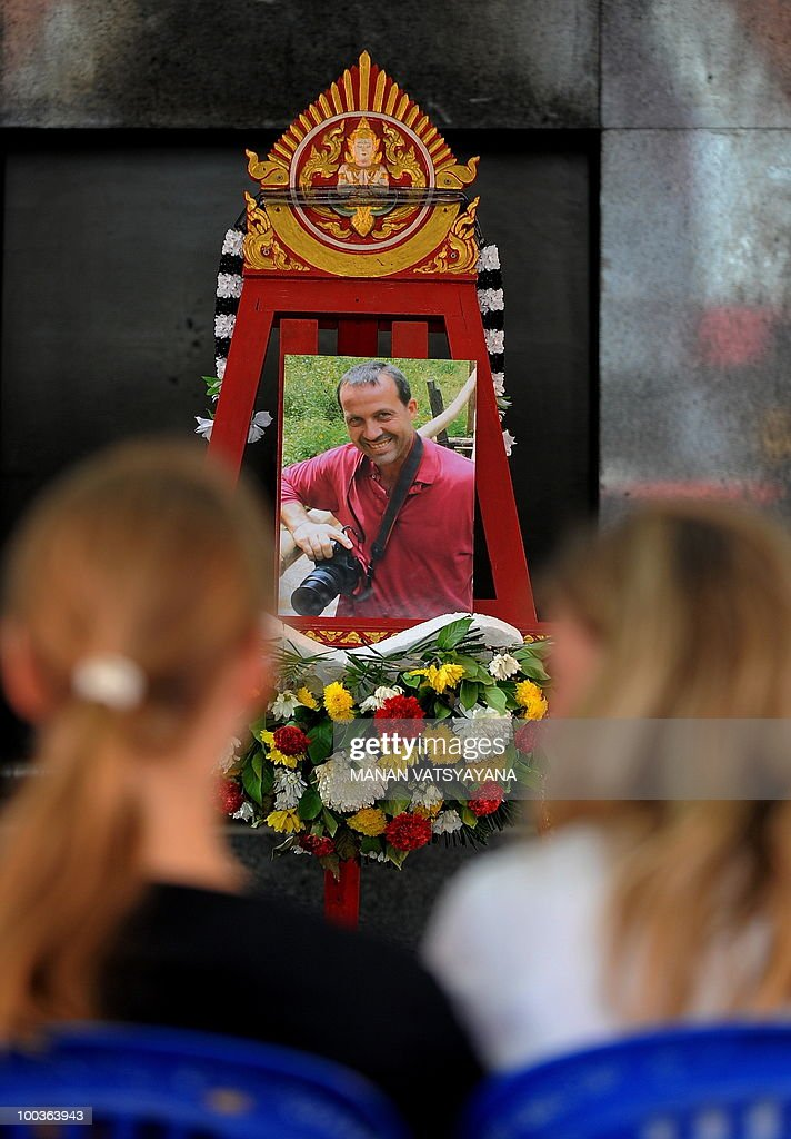 Friends and relatives of slain Italian photograher Fabio Polenghi attend his funeral at a temple in Bangkok on May 24, 2010. Polenghi, a freelance photographer and documentary maker, was shot while covering the military offensive to close down long-running 'Red Shirts' demonstrations in the capital on May 19.