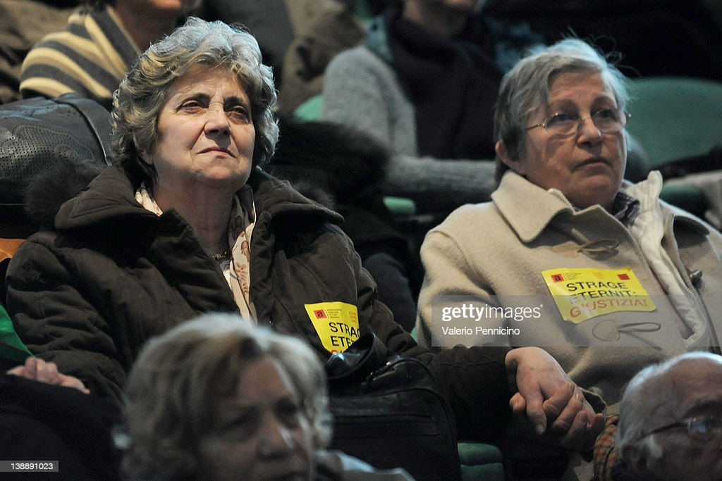 Friends and relatives of the victims comfort each other as they listen during the Eternit asbestos trial verdict reading on February 13, 2012 in Turin, Italy. The Turin court has convicted Swiss billionaire Stephan Schmindheiny and Belgian baron Jean-Louis de Cartier for 16 years each after they were accused of involuntary manslaughter and disregard for workplace safety regulations, after a three year trial. Around 1500 relatives and friends of the alleged 3000 victims attended the final day of the trial with 160 foreign delegations attending from all over the world.