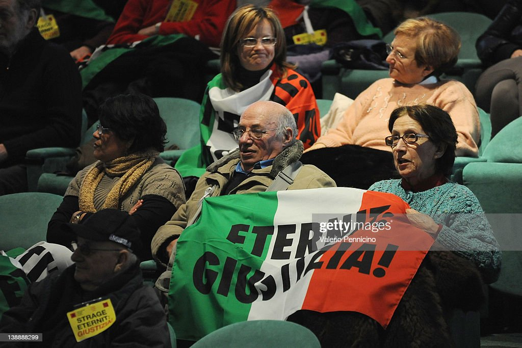 Friends and relatives of the victims holds a flag saying 'Eternit: Giustizia! - Eternit: Justice! during the Eternit verdict reading on February 13, 2012 in Turin, Italy. The Turin court has convicted Swiss billionaire Stephan Schmidheiny and Belgian baron Jean-Louis de Cartier for 16 years each after they were accused of involuntary manslaughter and disregard for workplace safety regulations, after a three year trial. Around 1500 relatives and friends of the alleged 3000 victims attended the final day of the trial with 160 foreign delegations attending from all over the world.