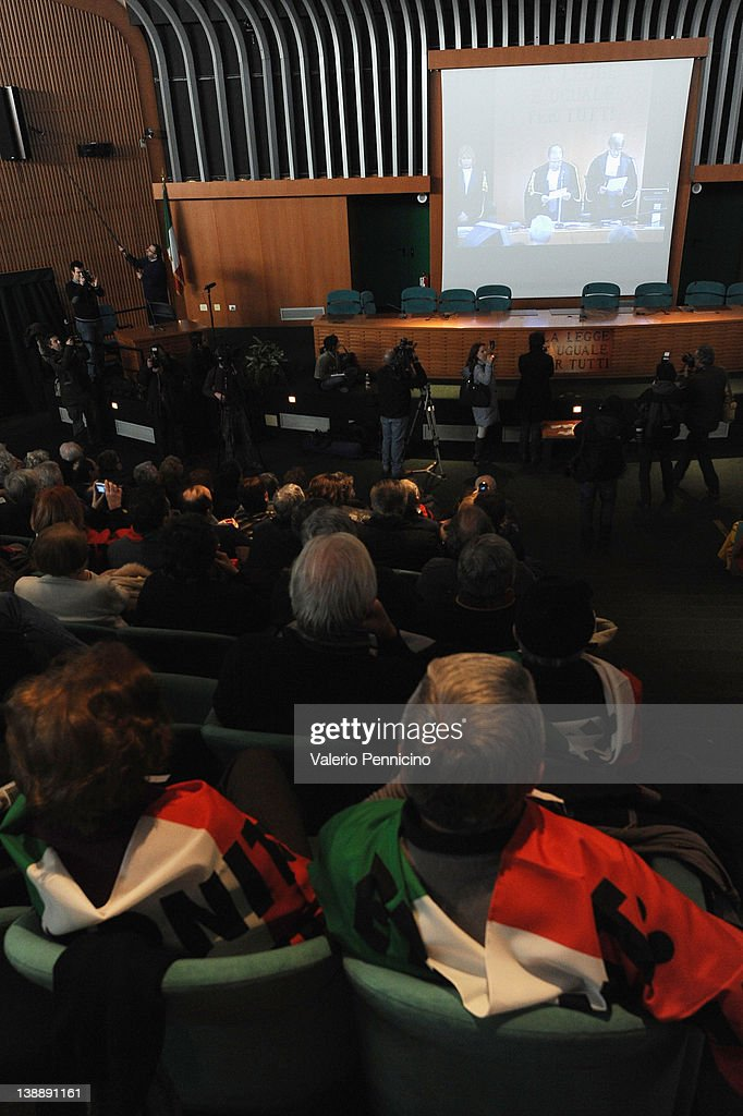 Friends and relatives of the victims listen to the Eternit verdict reading on February 13, 2012 in Turin, Italy. The Turin court has convicted Swiss billionaire Stephan Schmindheiny and Belgian baron Jean-Louis de Cartier for 16 years each after they were accused of involuntary manslaughter and disregard for workplace safety regulations, after a three year trial. Around 1500 relatives and friends of the alleged 3000 victims attended the final day of the trial with 160 foreign delegations attending from all over the world.