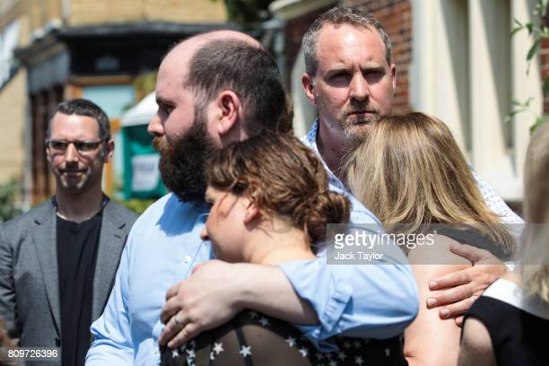 Friends and relatives pause outside the Jamyang Buddhist Centre following the funeral of Jon Underwood on July 6 2017 in London England The funeral...