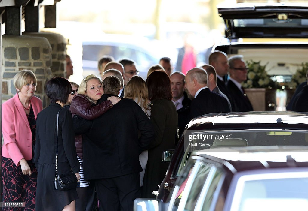 Friends and relatives react as the hearse carrying the two coffins containing the body of Ross Simons and his wife Clare arrives at Westerleigh Crematorium for their joint funeral on February 15, 2013 in Bristol, England. The couple were killed when their tandem bike collided with a car in Hanham. A 38-year-old man has been charged with two counts of causing death by dangerous driving after Ross Simons, 34, and Clare, 30, died at the scene of the crash in Bristol on January 27, 2013.