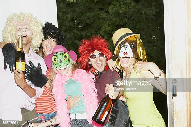 Friends arriving for party in costume