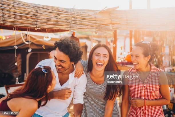 Friends at a beach camp