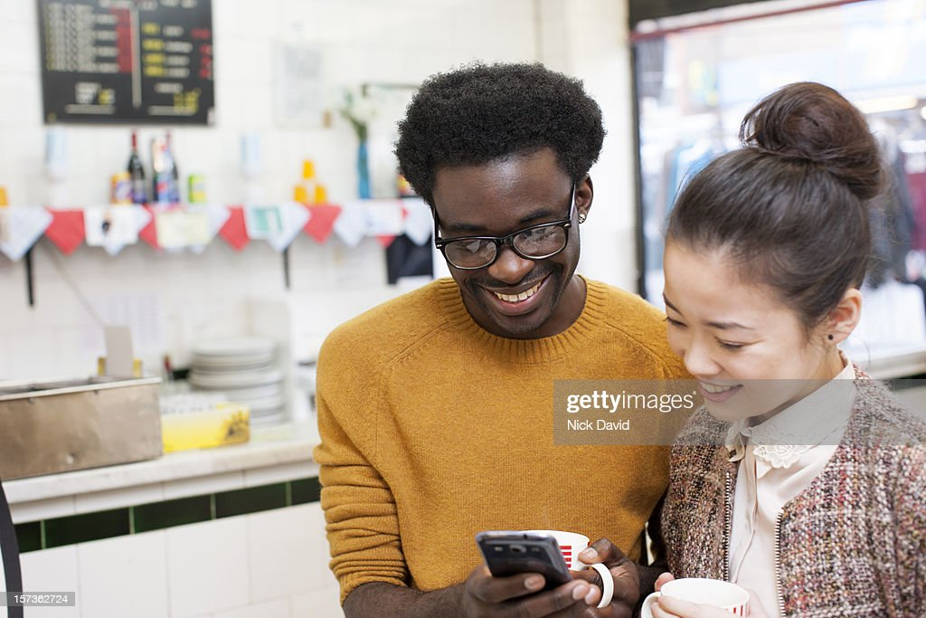 Friends at a cafe : Stock Photo
