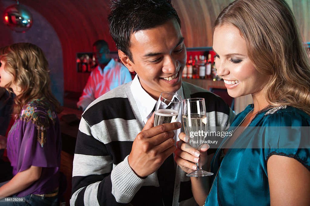 Friends at a club saluting drinks : Stock Photo